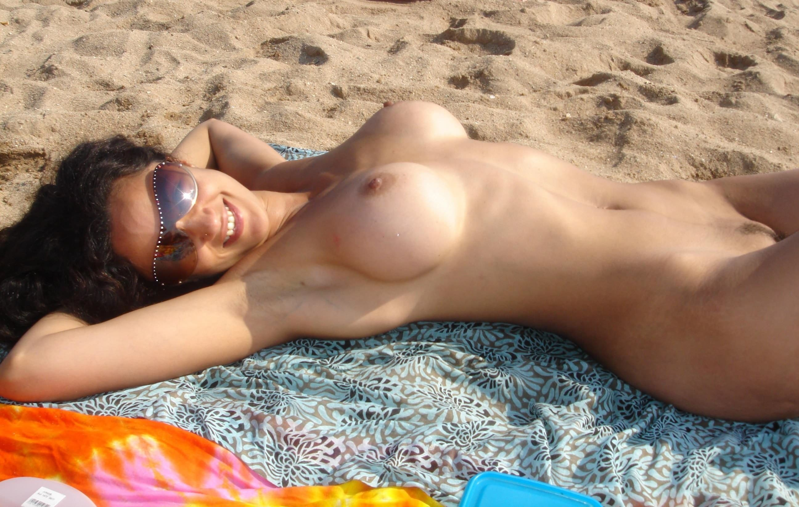 Sexy older woman lounging nude on the beach - Babes Gone Wild
